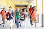 group high school students running along corridor towards camera smiling 41533709
